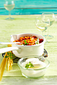 Vegetarian carrot and tomato bolognese in a small enamel pot