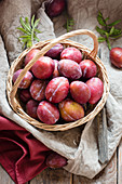 Plums in a wicker basket