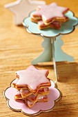 Shortbread star biscuits with raspberry jam and icing