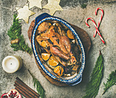 Roasted chicken for Christmas eve celebration table with holiday decorations on wooden board