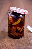 Roasted damsons in a screw-top jar