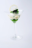 Lemon sorbet with parsley coulis and bananas served in a stemmed glass