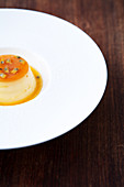 Creme caramel with mango and passion fruit sauce