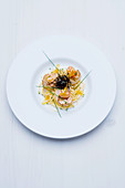 Fried scallops on capellini with bottarga and nori