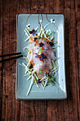 Barramundi sashimi on sweet-and-sour radish