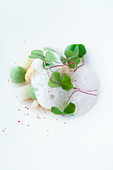 White asparagus with avocado cream, wood sorrel and pink pepper