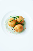 Potato dumplings with chive cream