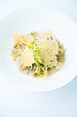 Braised Breton artichoke with frisée lettuce and Parmesan chips