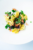 Pasta salad with broad beans, tomatoes and olives