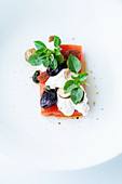 Roasted watermelon with goat's cheese and hazelnuts