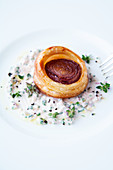 Red onion tart with thyme sauce