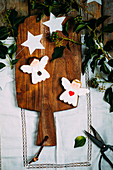 Royal icing cookies angels for Christmas on a wooden plank with white stairs