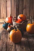 Thanksgiving pumpkins on old wood