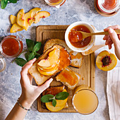 Tasty breakfast - Toasts of bread with apricot jam and fresh fruits