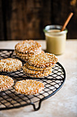 Tahini and sesame cookies on a cooling rack