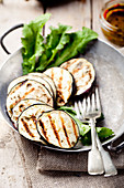 Grilled eggplants with salad leaves