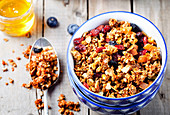 Honey glazed oatmeal, nuts, berries and flax seeds granola