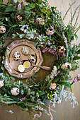 Easter wreath and quail eggs on silver tray