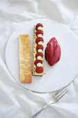 Cream puff pastry with fresh raspberries and raspberry sorbet