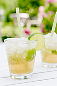 Virgin caipirinha cocktails with lime and ice cubes