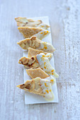 Caramel and almond corners with curry and white chocolate