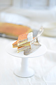 Baumkuchen corners (German layer cake) with a cake slice on a cake stand