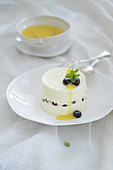 Lemon cream with blueberries and orange sauce