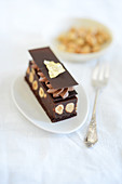 Chocolate-nut slices with chocolate mousse and gold leaf