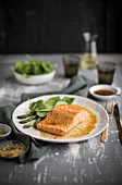Poached salmon with spinach and asparagus