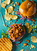 Meat free Vegan pulled pork made form soya and jack fruit in a barbeque sauce served on a brioche bun with pink winterslaw