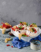 Mini pavlovas with cream and redcurrants