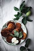 Apple pancakes on a plate (top view)