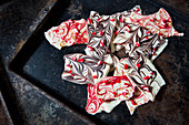 Marbled chocolate bark sprinkled with candy cane pieces