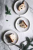 Tasty fresh baked Panettone served on plates on table
