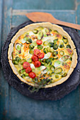 Brussels sprouts quiche with cherry tomatoes