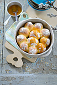 Freshly baked, sweet yeast dumplings with apricot glaze