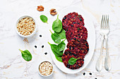Beetroot and quinoa patties with black beans, walnuts and spinach