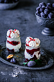 Plum desserts with meringues in glasses