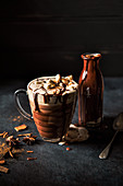 Spiced (cinnamon and star anise) hot chocolate with cream, marshmallows and chocolate sauce