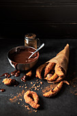 Churros with sugar cinnamon and dark chocolate sauce for dipping