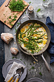 Smoked haddock with asparagus, peas, potatoes and dil in creamy garlic sauce