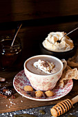 Hot chocolate topped with salted honey and whipped cream