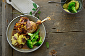Stuffed goose leg with chestnut potatoes and broccoli