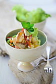 Oriental couscous salad with chicken breast and coconut