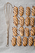 Nougat bars on baking paper with a whisk