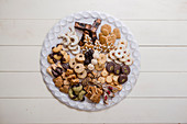 Various Christmas cookies on a biscuit platter (top view)