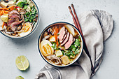 Asian Miso ramen with roasted beef, shiitake mushrooms, fried tofu, leek and eggs