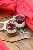Bavarian cheesecake with pomegranate seeds in glass jars