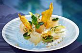Bream carpaccio with zucchini and fried fish skin