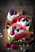 Watermelon slices with whipped cream and berries